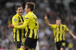 Mario Gotze and Robert Lewandowski celebrate a Borussia Dortmund goal against Real Madrid.